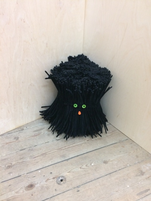 Anywhere But Here, 2019 1000 black pipe cleaners, 2 buttons, 1 ear bud 33x30x30 cm © Monty